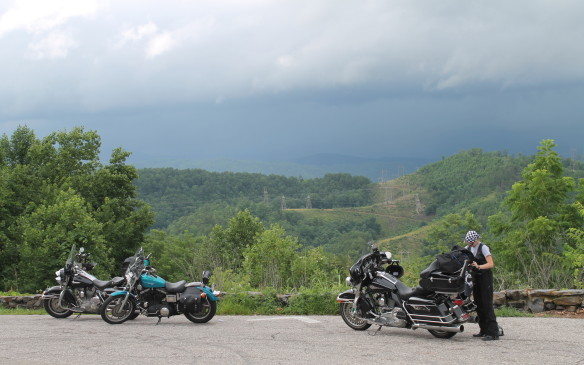 <p>The rain clouds gathered as we arrived, and the motorcyclists were putting on their rain gear.</p>