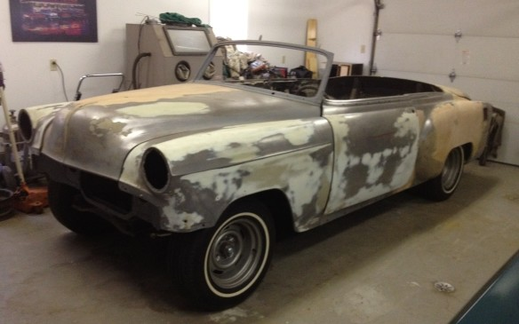 <p>Fresh off the flatbed trailer, minus a top and stripped of trim, the Bel Air is ready for media blasting to determine which parts of the car had suffered the most from demon rust.</p>