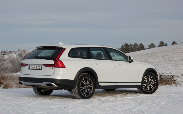 <p>This three-quarter rear view shows off the V90 Cross Country's smooth, sweeping roofline and the wide, trapezoidal, stainless steel exhaust outlets on either side of the aluminium rear skid plate. Under the power-assisted rear hatch, in keeping with Volvo's long wagon tradition, you will find 913 glorious litres of cargo volume (including the storage bins under the floor panel) when the rear seatbacks are in place and 1526 litres when the panels are folded flat. And the words Cross Country are still discreetly carved into the lower part of the bumper.</p>