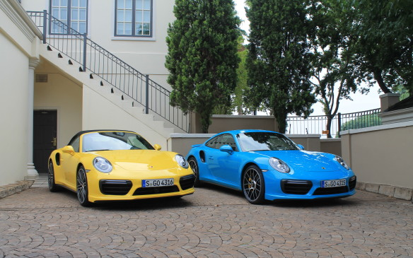 <p>It's almost impossible for a driver to tell the difference between the two Turbos. They're both insanely fast, and they're both enormously rewarding to drive. They have different stock wheels and a different chrome finish on their four exhaust tips, but that's about it. Here, the blue car is a Turbo, the yellow car a Turbo S.</p>