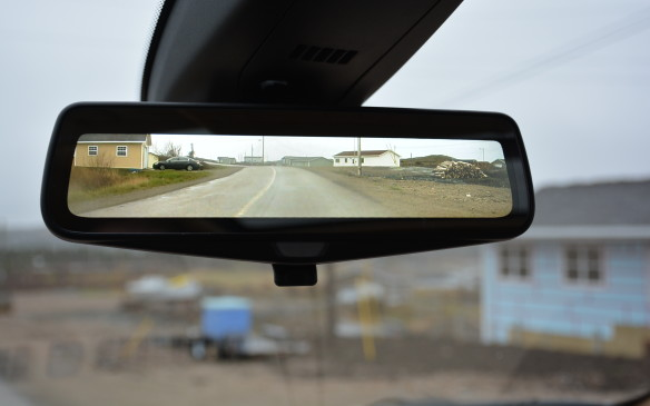 <p>There's still a regular interior rear-view mirror but with one flip it turns into a sharper rear camera mirror that increases rearward vision by 300%. This system – which comes with an auto wash feature for the camera – is only available standard in Platinum trim.</p>