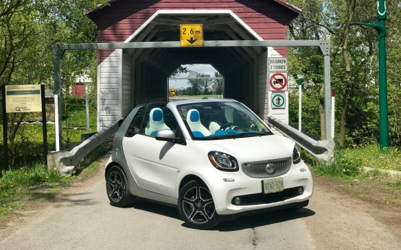 <p>Sadly, the power of the SL was wasted in the traffic around Montreal, and we changed over to a little Smart car. This is one of the least expensive convertibles available in Canada. We took it off the main highway to avoid the traffic and found a lovely covered bridge that reminded us of New Brunswick.</p>