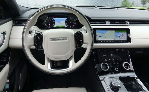 <p>The Velar is first to get Land Rover's new infotainment system that combines two ten-inch, high-definition touchscreens, topping a pair of large configurable knobs and a smaller one for the audio system, on a glass-like console that looks like a giant smartphone. The top screen can be tilted forward for better reach and view. On both, you can control systems, change settings, display the navigation map and generally swipe and surf through menus that control the climate, audio and vehicle systems, including several driving modes. Dead ahead is this superb, 12.3-inch HD display or twin 5-inch TFT gauges on S models.</p>