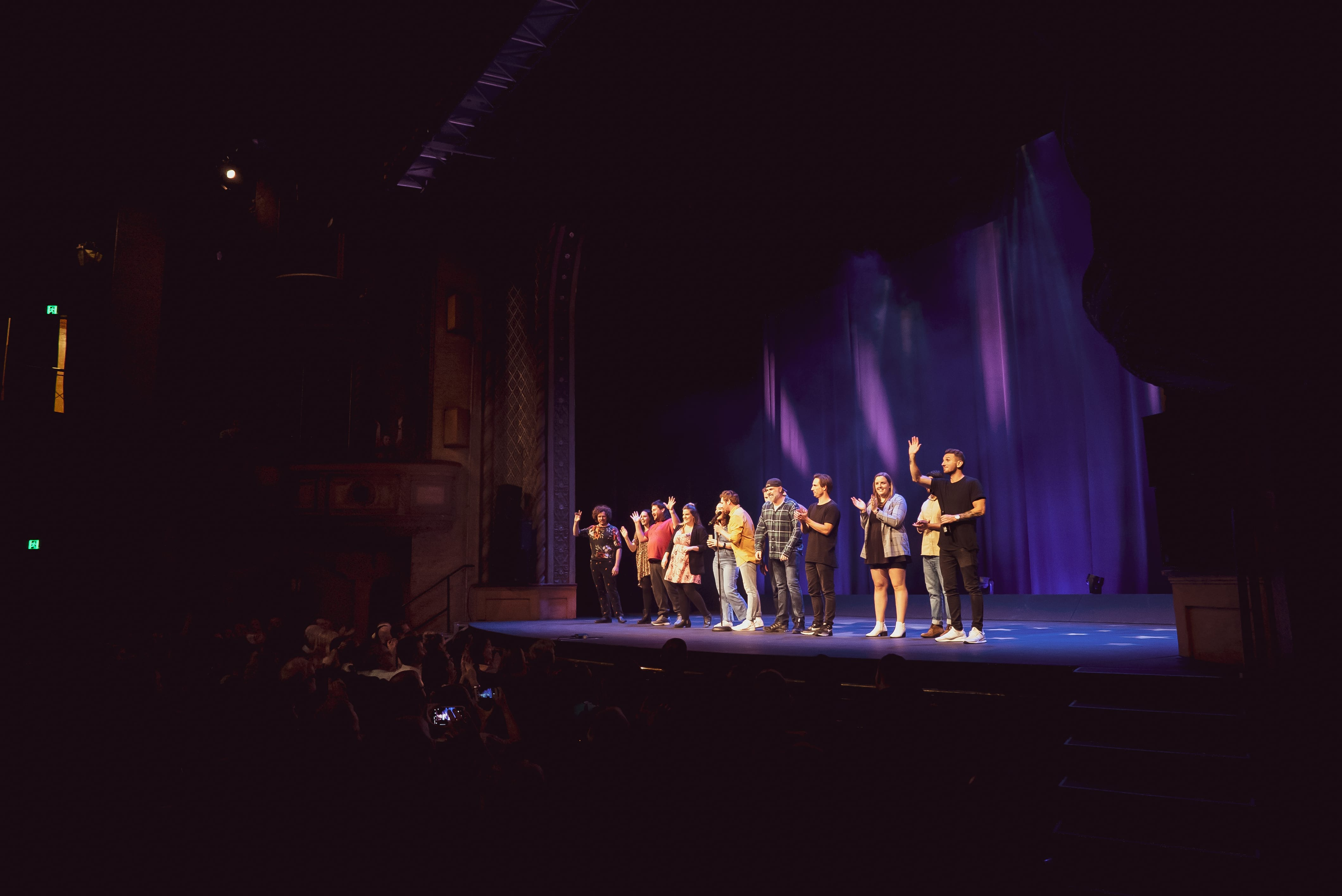 comedians tommy little standing on civic theatre stage at newcastle comedy festival