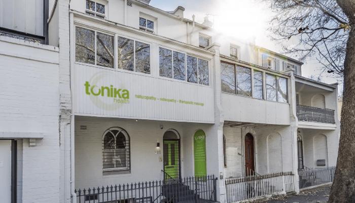 tonika-sign-on-balcony-front-mockup-Alex.png