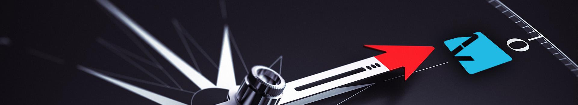 En kompassnål som peker på Avella-logoen