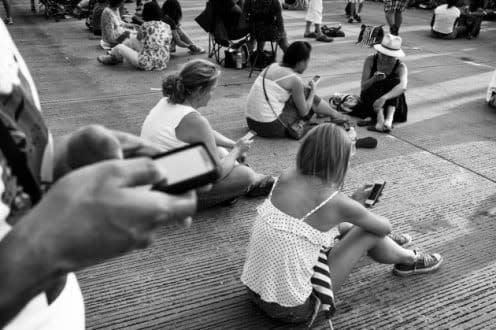A group of people using their phones.