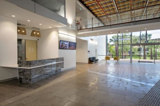 The foyer straddles a natural pedestrian route between the student village and the campus.