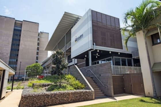 On the Flinders University NTMP building timber screens to windows filter natural light and protect the glass from cyclonic winds. Useable outdoor areas with ceiling fans to keep biting insects away and provide cooling are created under building overhangs.