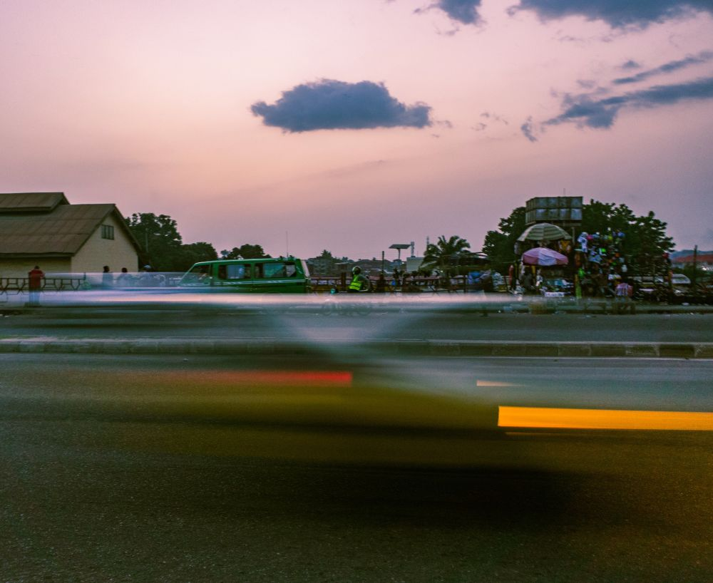 Motion blur of a taxi speeding through Challenge road
