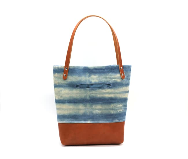 /az0062005-02_kzyb5o.jpg view of the Indigo Shibori Small Tote / Tan Leather by Azellaz