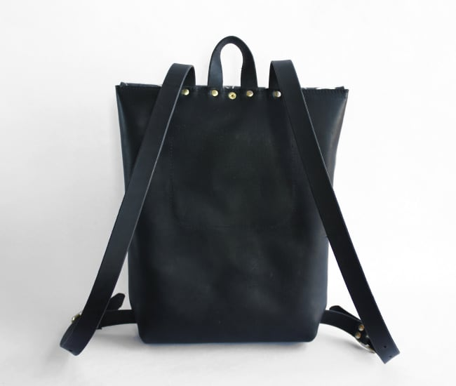 /backpackblack-back.jpg view of the Leather and Felt Backpack / Black and Navy by Azellaz