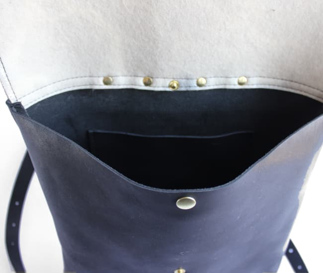 /backpackblack-inside.jpg view of the Leather and Felt Backpack / Black and Navy by Azellaz