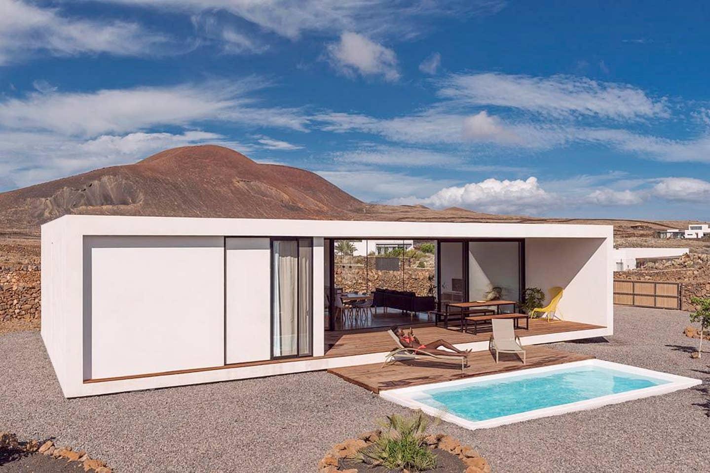 Minimalist house with heated pool