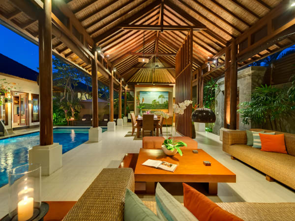 11. Lakshmi Villas - Toba - Living and dining areas at night