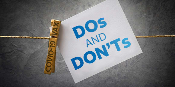 """image of the words """"Dos and Don'ts"""" and """"covid-16 vax"""" on clothes line"""
