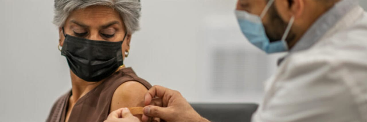 middle-aged woman getting her covid-19 vaccine