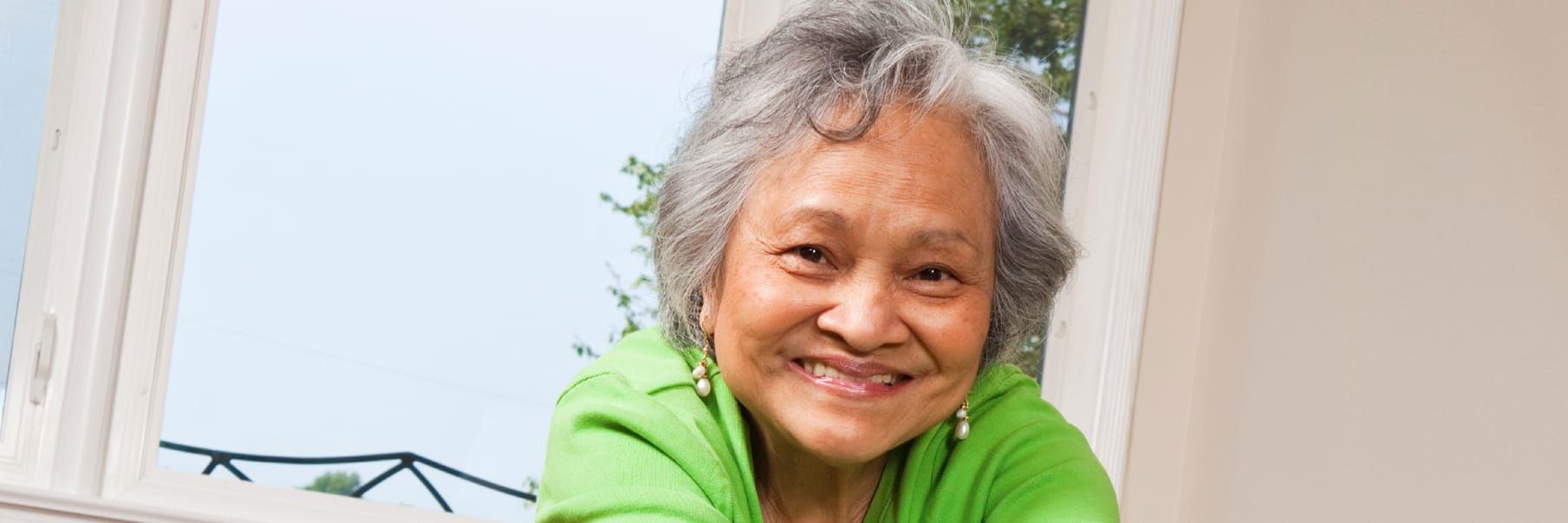 smiling older woman in a green shirt