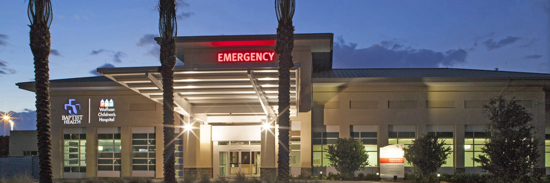 Exterior of the Baptist and Wolfson North emergency room at nightti