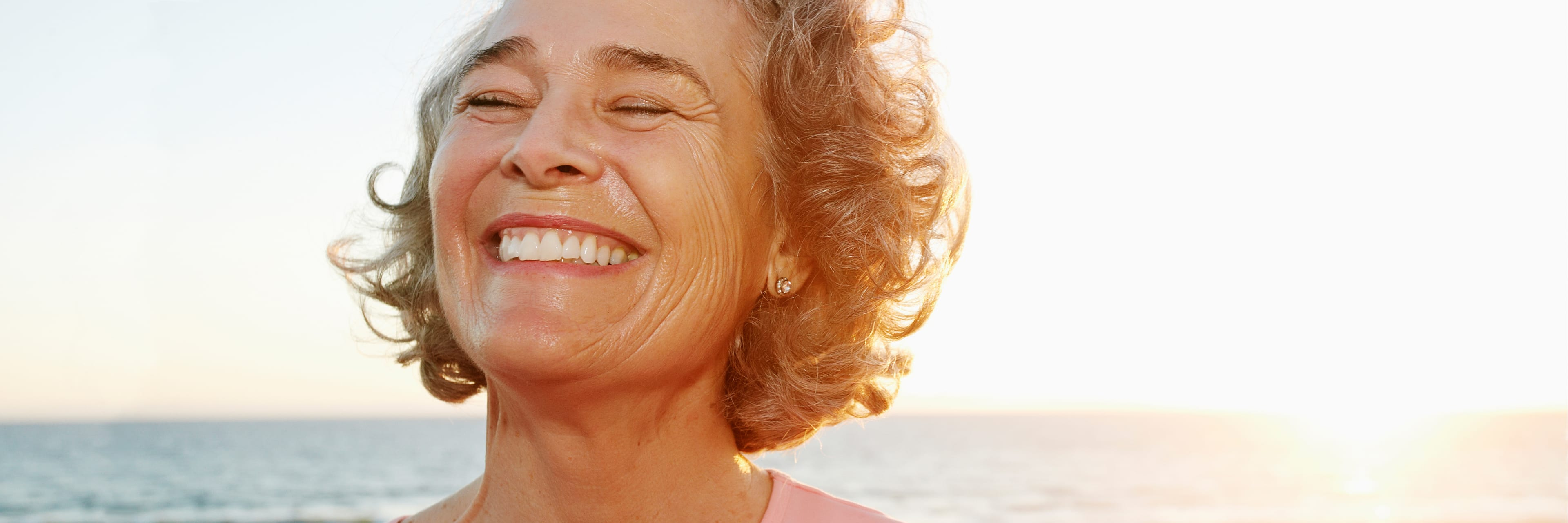 close up of woman smiling at beach