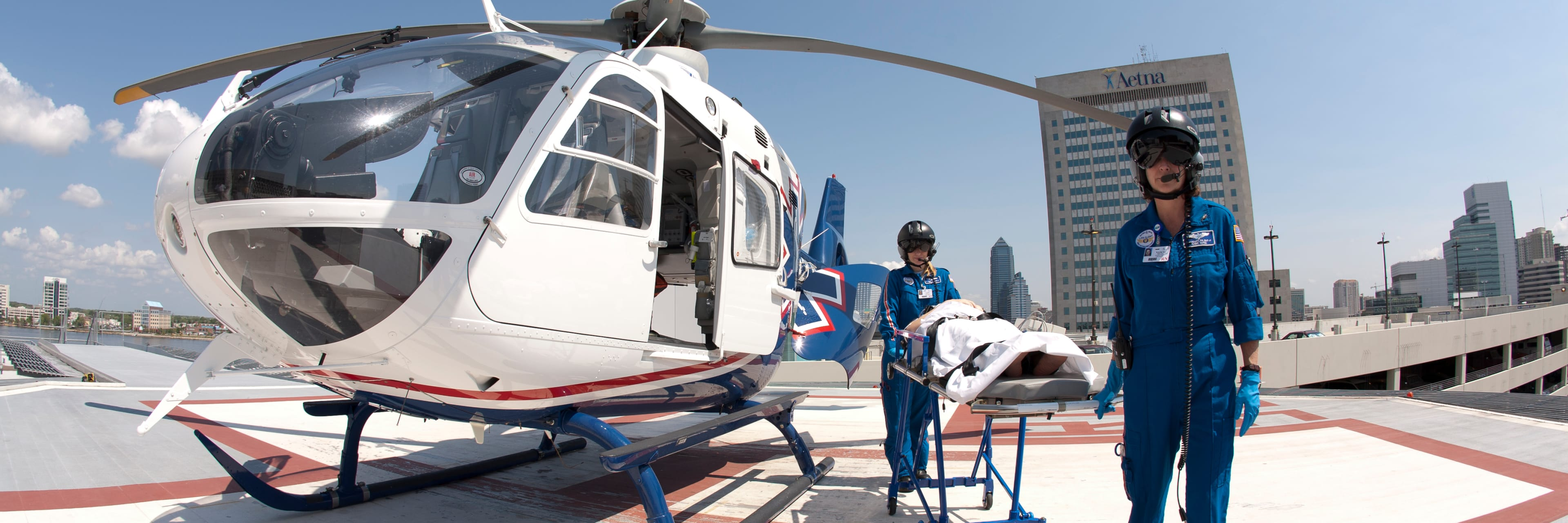 Medical workers next to an emergency helicopter on helipad