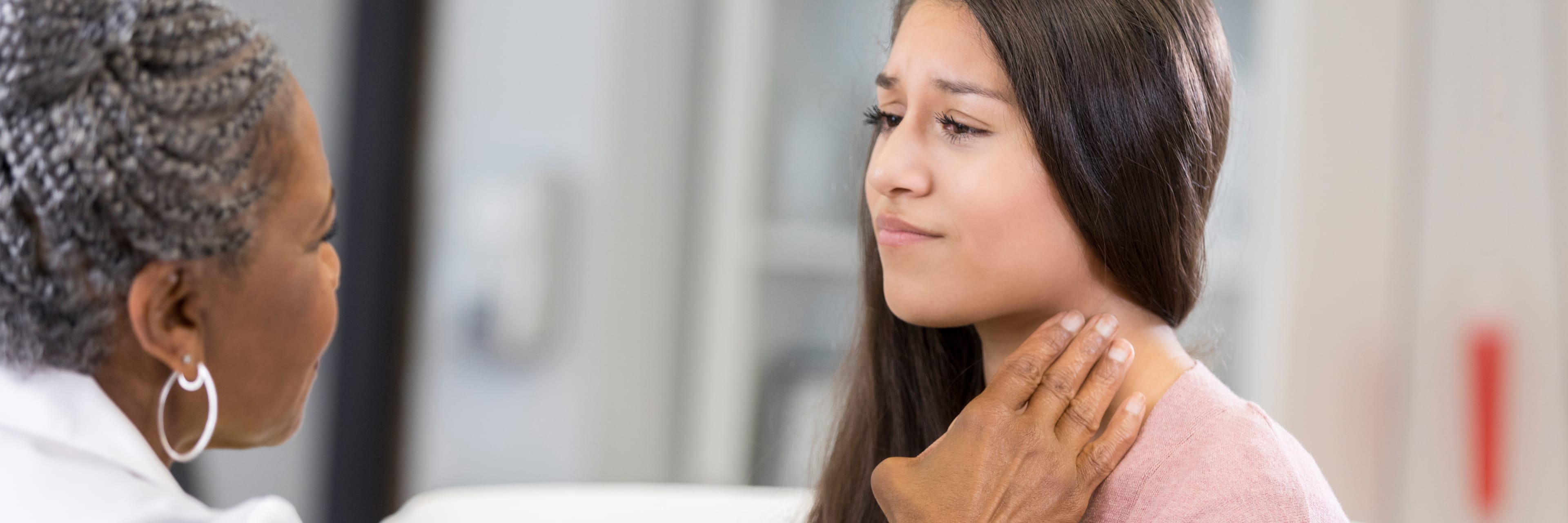 ENT physician checking woman's throat