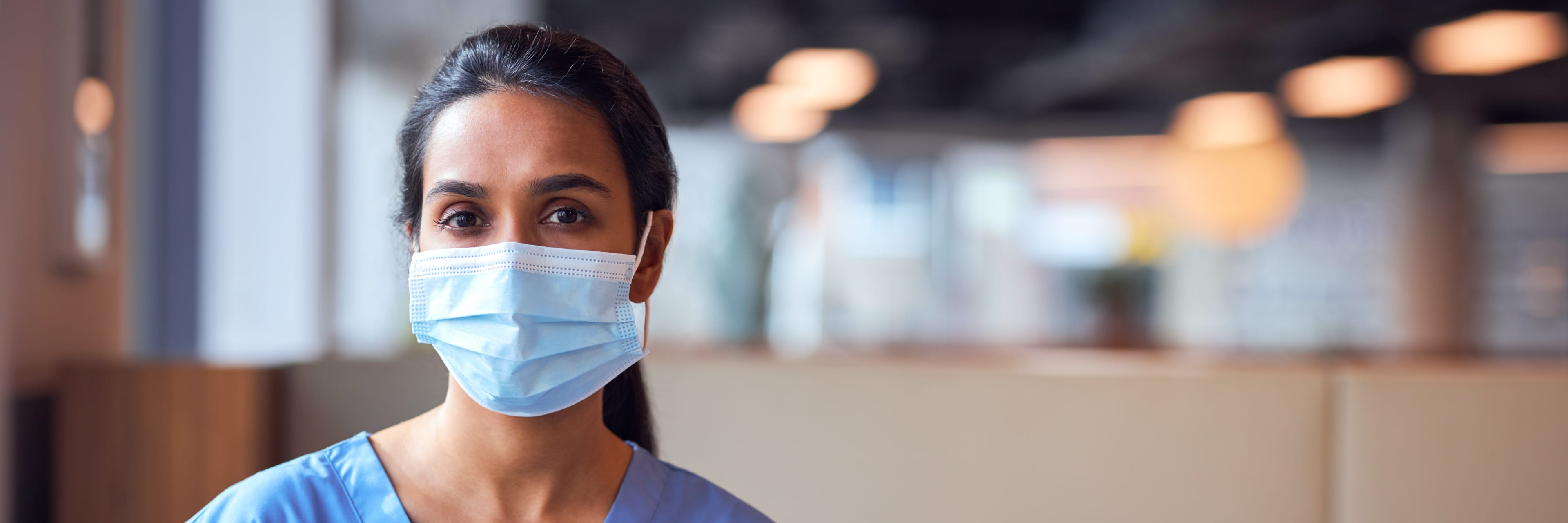 woman wearing a mask inside a building