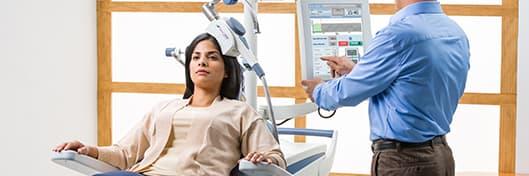 woman receiving Transcranial Magnetic Stimulation treatment