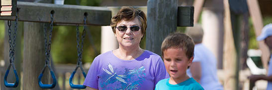 grandmother on playground with grandson