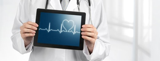 Doctor holding a tablet with an echocardiogram