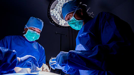 surgeons in the operating room during surgery