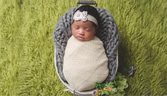 Little infant lying in bassinette.