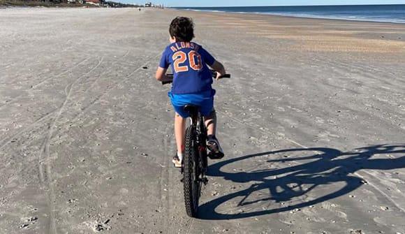 teen riding a bike