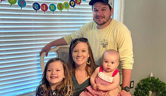 Josh and Ashleigh Atkinson with their daughters
