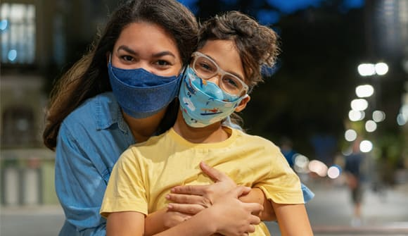 Mom and child in masks