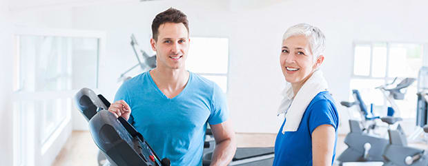 medical professional working with patient on treadmill