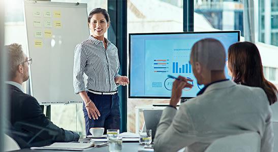 female employer giving presentation