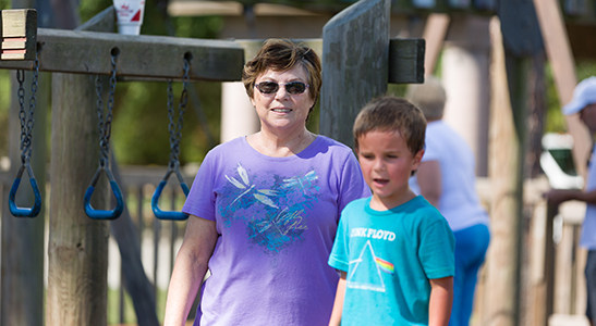 grandmother on playground with grandson