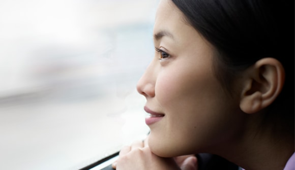 Woman staring out of a window