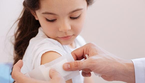 little girl receiving flu shot