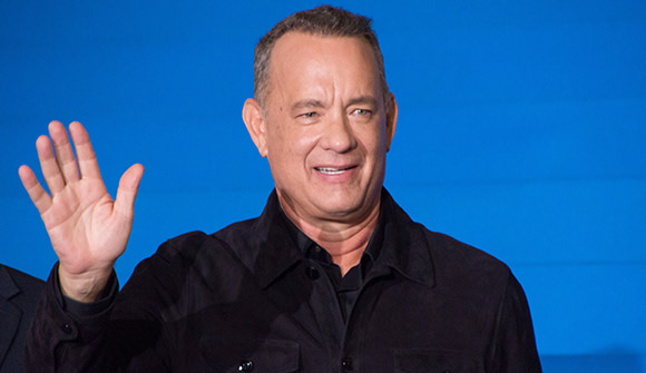 actor Tom Hanks, COVID-19 survivor, waving