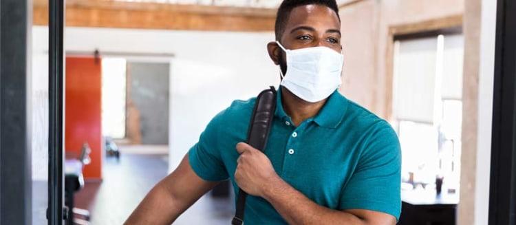 employee wearing surgical mask