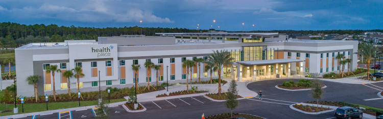 an exterior view of the HealthPlace at Nocatee building in the evening