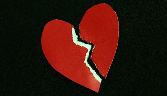 a red heart broken in half