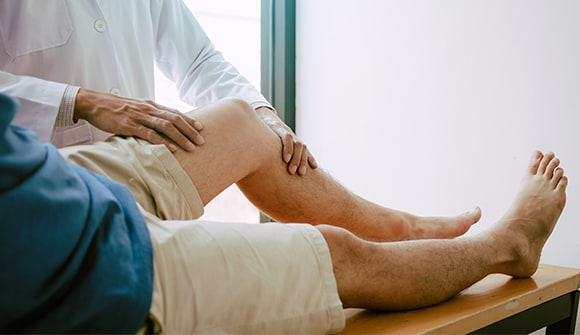 Man having leg examined by a doctor.