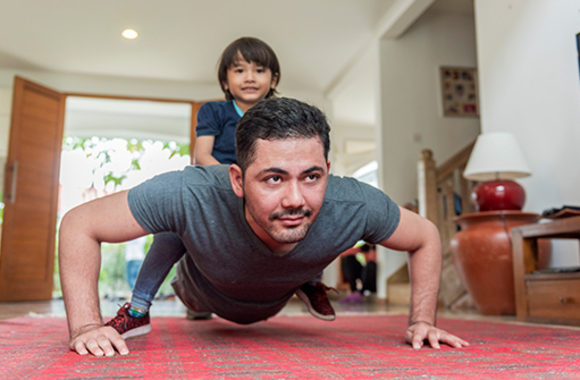 working out at home dad with child