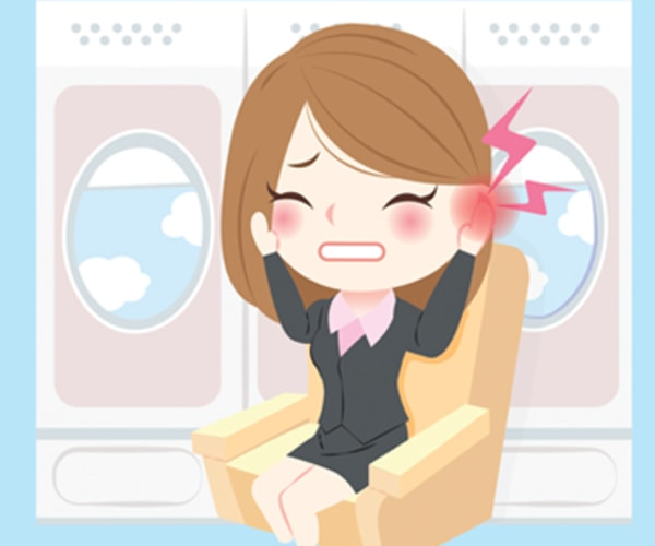 woman on flight with earache