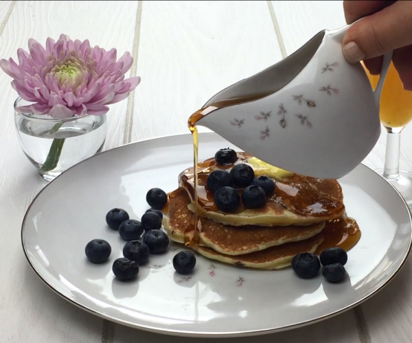 Blueberry ricotta pancakes with maple syrup