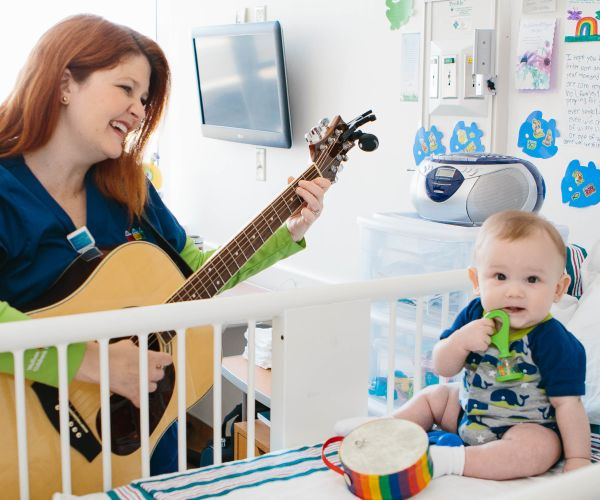 music therapist plays for baby