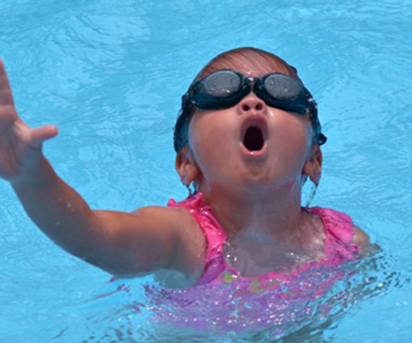 Child in pool gasping for air.